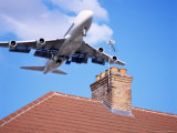 Low-Flying Aircraft Over Rooftops Near London Heathrow Airport, Greater London, England Photographic Print by Mark Mawson