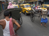 Hand Pulled Rickshaws and Yellow Taxis, Kolkata, West Bengal State, India Photographic Print by Eitan Simanor