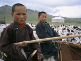 Young Boys on Horseback Herding Sheep, Mongolia, Central Asia Photographie par Bruno Morandi