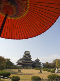 Matsumoto Castle Under Red Parasol, Nagano Prefecture, Kyoto, Japan Photographic Print by Christian Kober