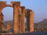 Monumental Arch at Archaeological Site, with Arab Castle Beyond, Palmyra, Syria Photographic Print by Bruno Morandi