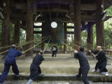 Monks Pulling Ropes of Big Bell, Chion in Temple, Eastern Hills, Higashiyama, Kyoto, Japan Photographic Print by Christian Kober