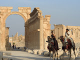 Young Men on Camels, Monumental Arch, Archaelogical Ruins, Palmyra, Syria Photographic Print by Christian Kober