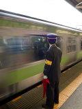 Platform Conductor, Subway Train at Rush Hour, Shinjuku, Tokyo, Honshu, Japan Photographic Print by Christian Kober