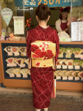 Girl in Kimono, Yukata Buying Crepe, Kyoto City, Honshu, Japan Photographic Print by Christian Kober