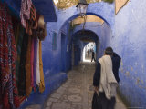 Man Walking Through Pastel Coloured Streets of Chefchaouen, Morocco, North Africa, Africa Photographic Print by Christian Kober