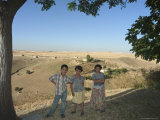 Children Under Tree, Apamea (Qalat at Al-Mudiq), Syria, Middle East Photographic Print by Christian Kober