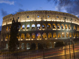 The Colosseum at Night with Traffic Trails, Rome, Lazio, Italy Photographic Print by Christian Kober