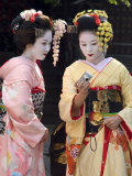 Geisha, Maiko (Trainee Geisha) in Gion, Kyoto City, Honshu, Japan Photographic Print by Christian Kober