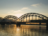 Sunset on the Daugava River and Steel Arches of Railway Bridge, Riga, Latvia, Baltic States Photographic Print by Christian Kober