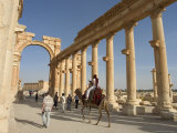 Tourist Camel Ride, Monumental Arch, Archaelogical Ruins, UNESCO World Heritage Site, Syria Photographic Print by Christian Kober