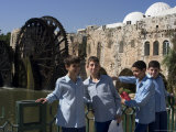 School Boys, in Front of a Mosque and Water Wheel on the Orontes River, Hama, Syria, Middle East Photographic Print by Christian Kober