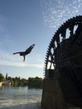 Man Diving off Water Wheel, Orontes River, Hama, Syria, Middle East Photographic Print by Christian Kober