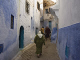 Woman Walking Through Pastel Coloured Streets of Chefchaouen, Morocco, North Africa, Africa Photographic Print by Christian Kober