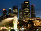 Merlion Fountain with Statue of Half Lion and Fish, with City Buildings Beyond, Southeast Asia Photographic Print by Richard Nebesky