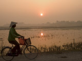Bicycle in the Morning Mist at Sunrise, Limestone Mountain Scenery, Tam Coc, South of Hanoi Photographic Print by Christian Kober