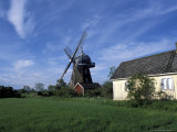 Landscape with Wooden Windmill and Two Houses in the Village of Kvarnbacken, Oland Island, Sweden Photographic Print by Richard Nebesky