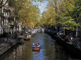 Small Boat on Tree-Lined Oudezijds Achtenburg Wal Canal in the Autumn, Amsterdam, the Netherlands Photographic Print by Richard Nebesky