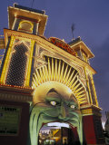 Exterior of Luna Park Entrance Illuminated at Twilight, St. Kilda, Melbourne, Victoria, Australia Photographic Print by Richard Nebesky
