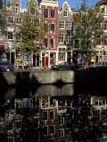 Tall Traditional Style Houses Reflected in the Water of a Canal, Amsterdam, the Netherlands Photographic Print by Richard Nebesky