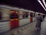 Train Gathering Speed Leaving the Platform at Mustek Station, Prague, Czech Republic Photographic Print by Richard Nebesky