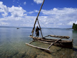 Fisherman on a Boat, Zanzibar, Tanzania, East Africa, Africa Photographic Print by Yadid Levy