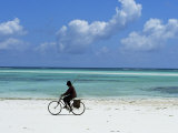 A Man Riding His Bicycle of Kiwengwa Beach, Island of Zanzibar, Tanzania, East Africa, Africa Photographic Print by Yadid Levy