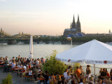People at Trendy Rheinterrassen Bar and Restaurant Beside the River Rhine, Cologne, Germany Photographic Print by Yadid Levy
