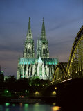 Cologne Cathedral, and Hohenzollern Bridge at Night, North Rhine Westphalia Photographic Print by Yadid Levy