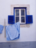 Laundry Hanging on Line at Window in the Moorish Quarter of Alfama, Lisbon, Portugal Photographic Print by Yadid Levy