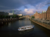 Excursion Boat on Canal in the Speicherstadt, the Historical Warehouse City Area, Hamburg, Germany Photographic Print by Yadid Levy