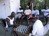 Fishermen Playing Checkers, Charlotteville, Tobago, West Indies, Caribbean, Central America Photographic Print by Yadid Levy
