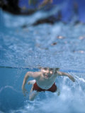Little Boy Swimming Underwater Photographic Print by James Gritz