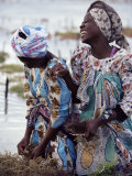 Two Smiling Zanzibari Women Working in Seaweed Cultivation, Zanzibar, Tanzania, East Africa, Africa Photographic Print by Yadid Levy
