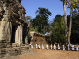 A Procession of Buddhist Nuns File Through the Temples of Angkor, Cambodia, Southeast Asia Photographic Print by Andrew Mcconnell