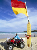 Swimming Flag and Patrolling Lifeguard at Bondi Beach, Sydney, New South Wales, Australia Photographic Print by Robert Francis