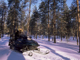 Woman Driving Snowmobile Near Lulea, Lapland, Sweden, Scandinavia Photographic Print by Sergio Pitamitz
