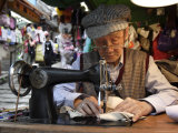 A Tailor at Work in Hong Kong, China Photographic Print by Andrew Mcconnell