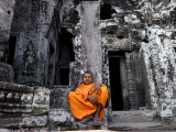 A Buddhist Monk Relaxes in the Bayon Temple, Angkor, Unesco World Heritage Site, Cambodia Photographic Print by Andrew Mcconnell
