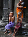 Young Buddhists Have Their Heads Shaved as an Offering to Buddha, Cambodia, Southeast Asia Photographic Print by Andrew Mcconnell