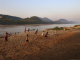 Playing Football on the Banks of the Mekong River, Luang Prabang, Laos, Indochina Photographic Print by Andrew Mcconnell
