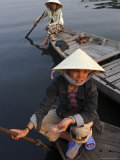 Women Ferrying Boats Await a Fare, Hoi An, Vietnam, Indochina, Southeast Asia Photographic Print by Andrew Mcconnell