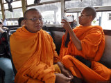 A Buddhist Monk Uses His Camcorder on a Bus in Vientiane, Laos, Indochina, Southeast Asia Photographic Print by Andrew Mcconnell