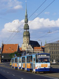 Tram, with St. Peter Church in the Background, Riga, Latvia, Baltic States Photographic Print by Yadid Levy