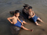 Two Boys Bathe with Their Water Buffalo in the Mekong River, Eastern Cambodia, Indochina Photographic Print by Andrew Mcconnell
