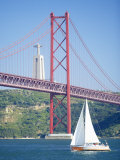 25th April Bridge Over the Tagus River and the Christ Statue in Background Photographic Print by Marco Simoni
