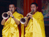 Monks Blowing Flutes Outside a Gompa (Tibetan Monastery), Bodhnath, Katmandu, Nepal Photographic Print by Marco Simoni