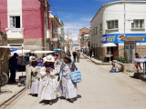Women Walking Down Street, Copacabana, Laketiticaca, Bolivia, South America Photographic Print by Marco Simoni