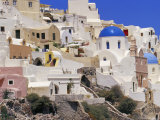 Village of Oia with Blue Churches and Colourful Dwellings, Oia, Santorini (Thira), Greece Photographic Print by Marco Simoni