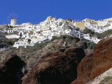 Oia Village and Volcanic Rocks, Santorini (Thira), Cyclades Islands, Greece, Mediterranean Photographic Print by Marco Simoni